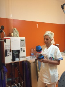 Nurse explaining some of the tools they use on daily basis. - Machine to send blood samples to the testing lab.